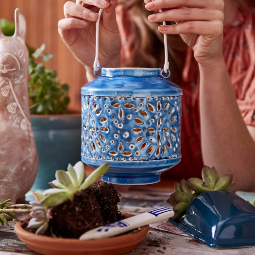 """Indoor/Outdoor Tealight Lantern - Garden Party ($26)  Measurements: 5"""" D x 5.75"""" T, with 4"""" handle.""""  Materials: Enamel-painted stainless steel. Care Instructions: Handwash recommended. Please note the outer surface heats with a tea light, electric tea light recommended.  Country of Origin: India."""